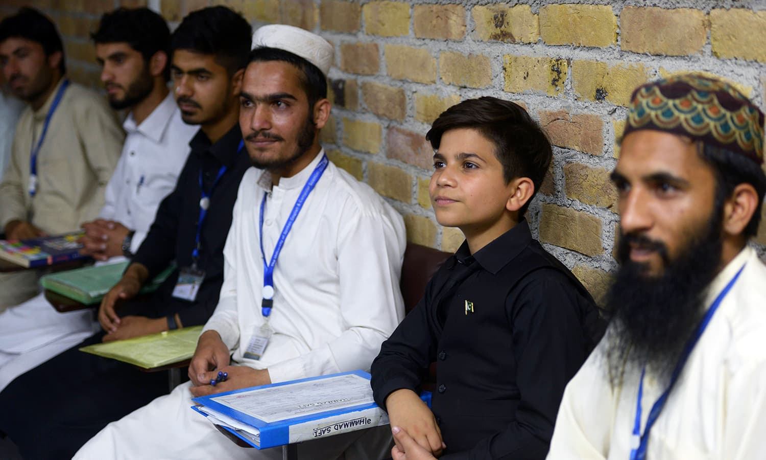 Hammad Safi (2nd R) attends an English language class at a languages academy in Peshawar. — AFP