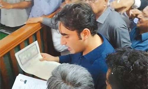 Pakistan Peoples Party Chairman Bilawal Bhutto-Zardari submits his [nomination papers][1] to presiding officer at City Court in Karachi on Thursday.—PPI