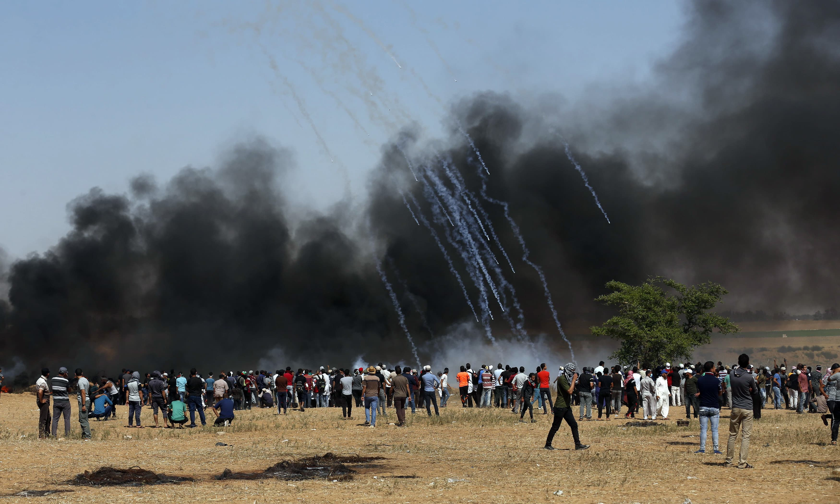 Tear gas canisters are fired by Israeli forces towards a group of Palestinian protesters. —AFP