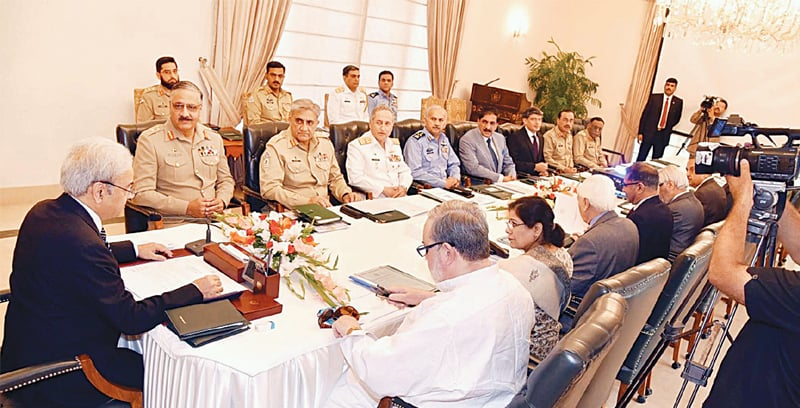 ISLAMABAD: Prime Minister retired Justice Nasirul Mulk chairs a meeting of the National Security Committee at the PM Office on Friday.—PPI