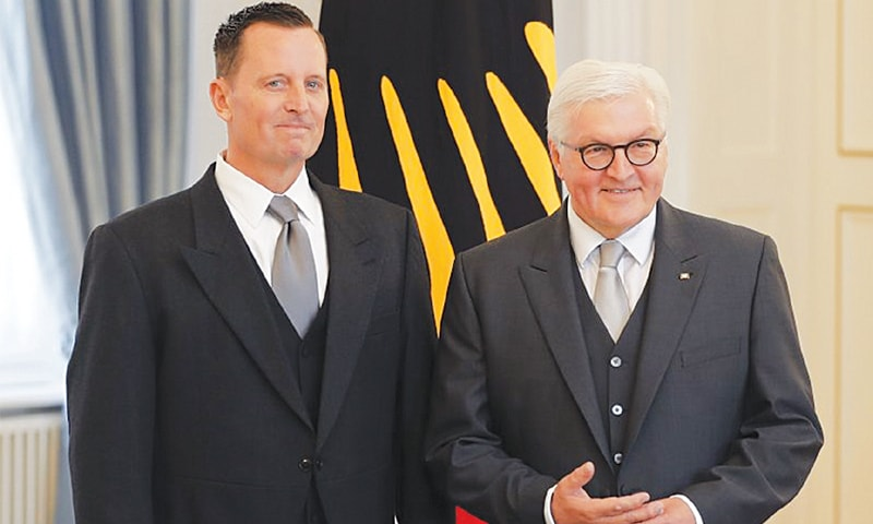GERMAN President Frank-Walter Steinmeier (right) and US Ambassador to Germany Richard Allen Grenell pose for media in Berlin. Grenell, a Trump loyalist and former Fox News contributor, presented his credentials to the German president on May 8.—AP