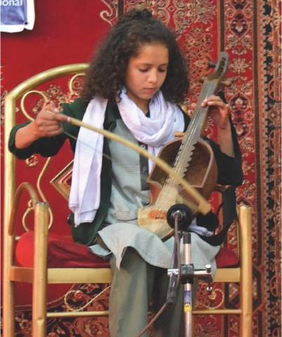 A student from Ghulkin village plays the ghazek