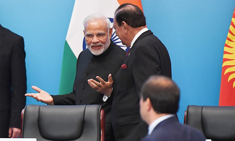 Indian Prime Minister Narendra Modi (L) talks with President Mamnoon Hussain after a signing ceremony during the SCO Summit. — AFP