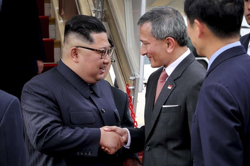 In this photo released by the Ministry of Communications and Information of Singapore, North Korean leader Kim Jong Un, left, is greeted by Singapore Minister for Foreign Affairs Dr Vivian Balakrishnan at the Changi International Airport on Sunday. ─ AP