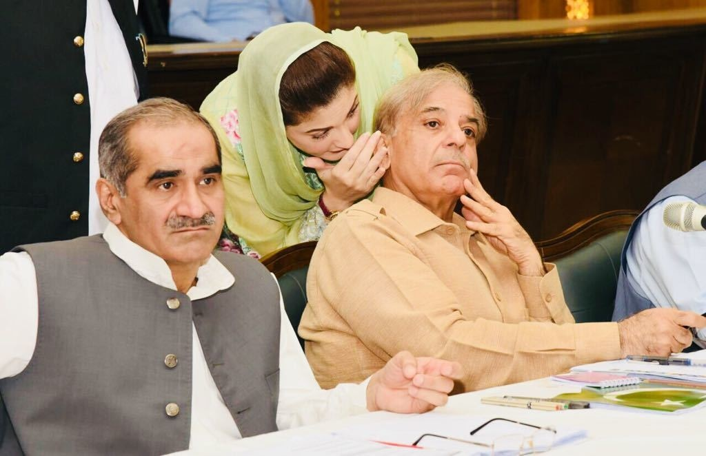 Maryam Nawaz whispers in Shahbaz Sharif's ear during a session for interviewing PML-N ticket aspirants on June 10.