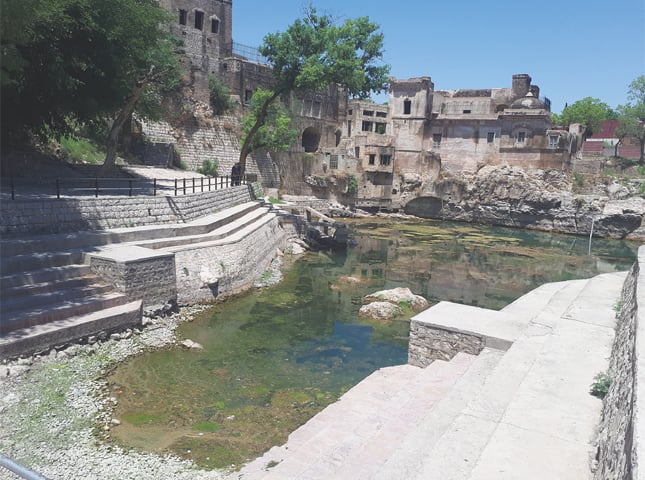 THE fabled Katas Raj pond carries the little water that is dropped into it daily through a water bore drilled half a kilometre away.—Photo by writer