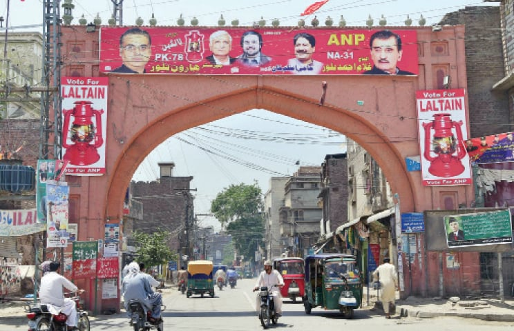 As election related activities are picking up across Peshawar, a political party has displayed its banners on Lahori Gate. — White Star