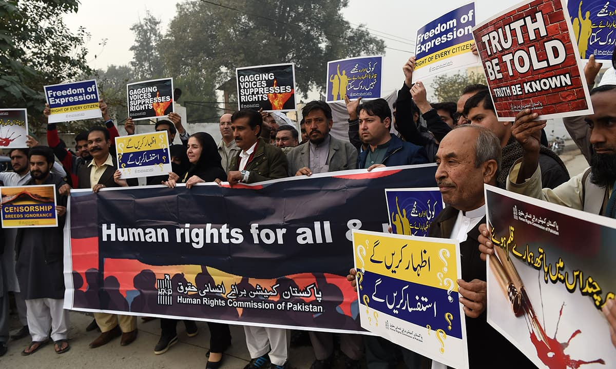 Human rights activists hold placards during a walk held in Peshawar on the eve of International Human Rights Day | Shahbaz Butt, White Star