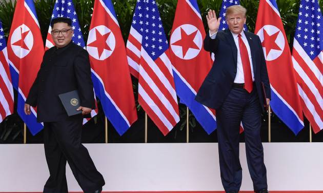 North Korea leader Kim Jong Un and US President Donald Trump at the Capella resort on Sentosa Island on Tuesday in Singapore. — AP
