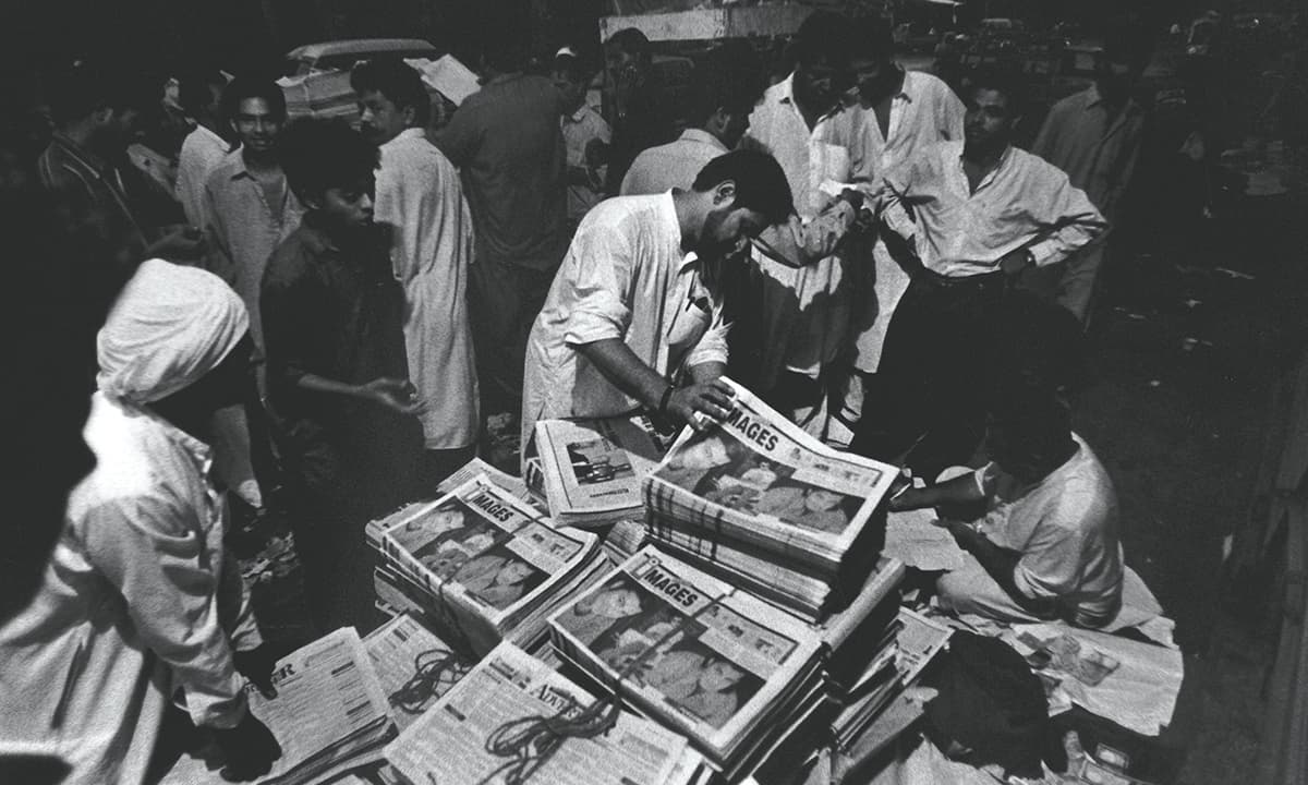 Early morning at a newspaper distribution depot in New Challi, Karachi in 1997 | Arif Mahmood, White Star