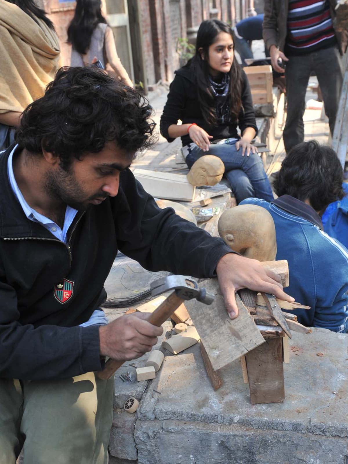 A student of National College of Arts works on a sculpture | M Arif, White Star