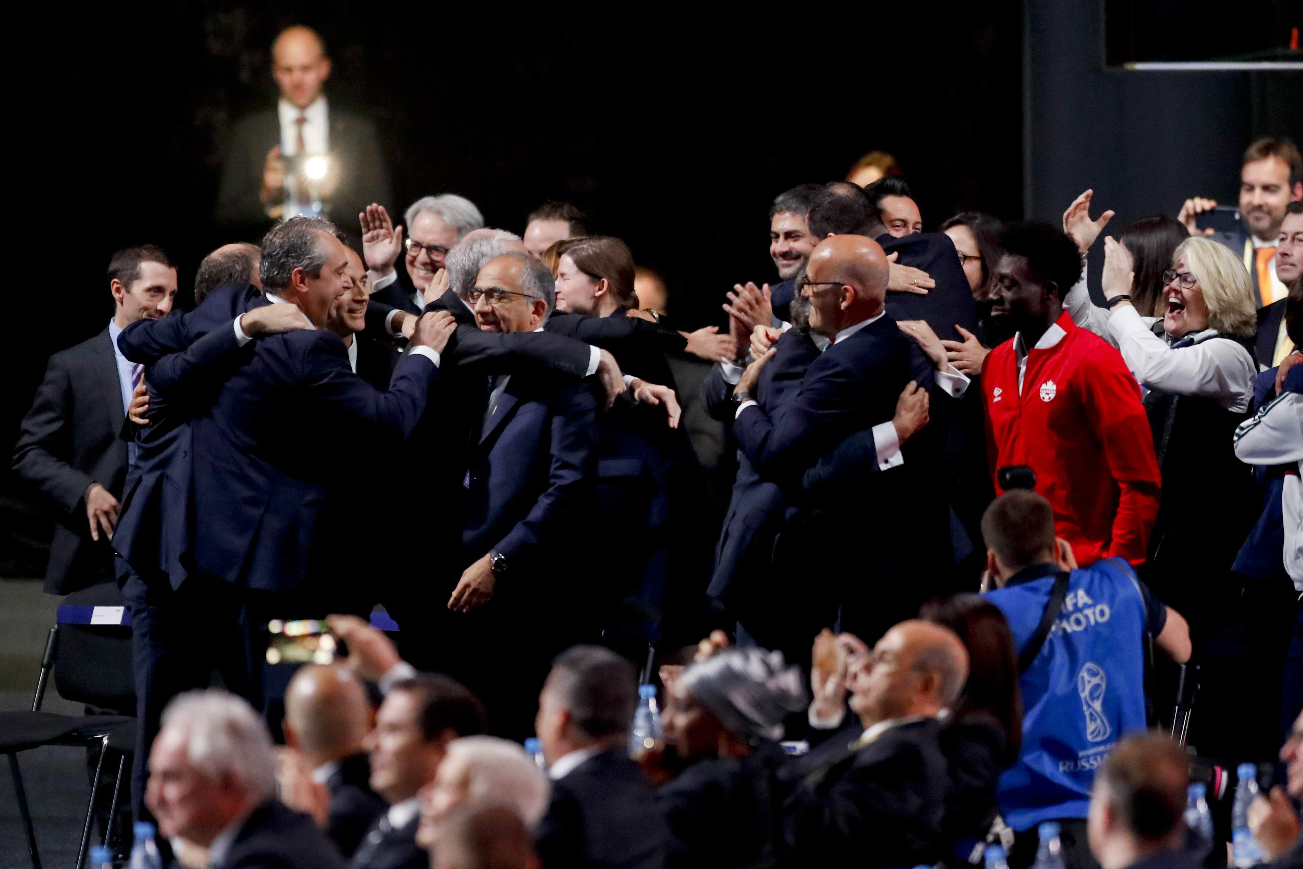 Delegates of Canada, Mexico and the United States celebrate after winning a joint bid to host the 2026 World Cup at the FIFA congress in Moscow, Russia, Wednesday. — AP