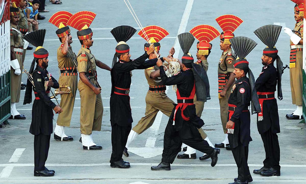 Guards participate in the flag lowering ceremony at Wagah border near Lahore | White Star