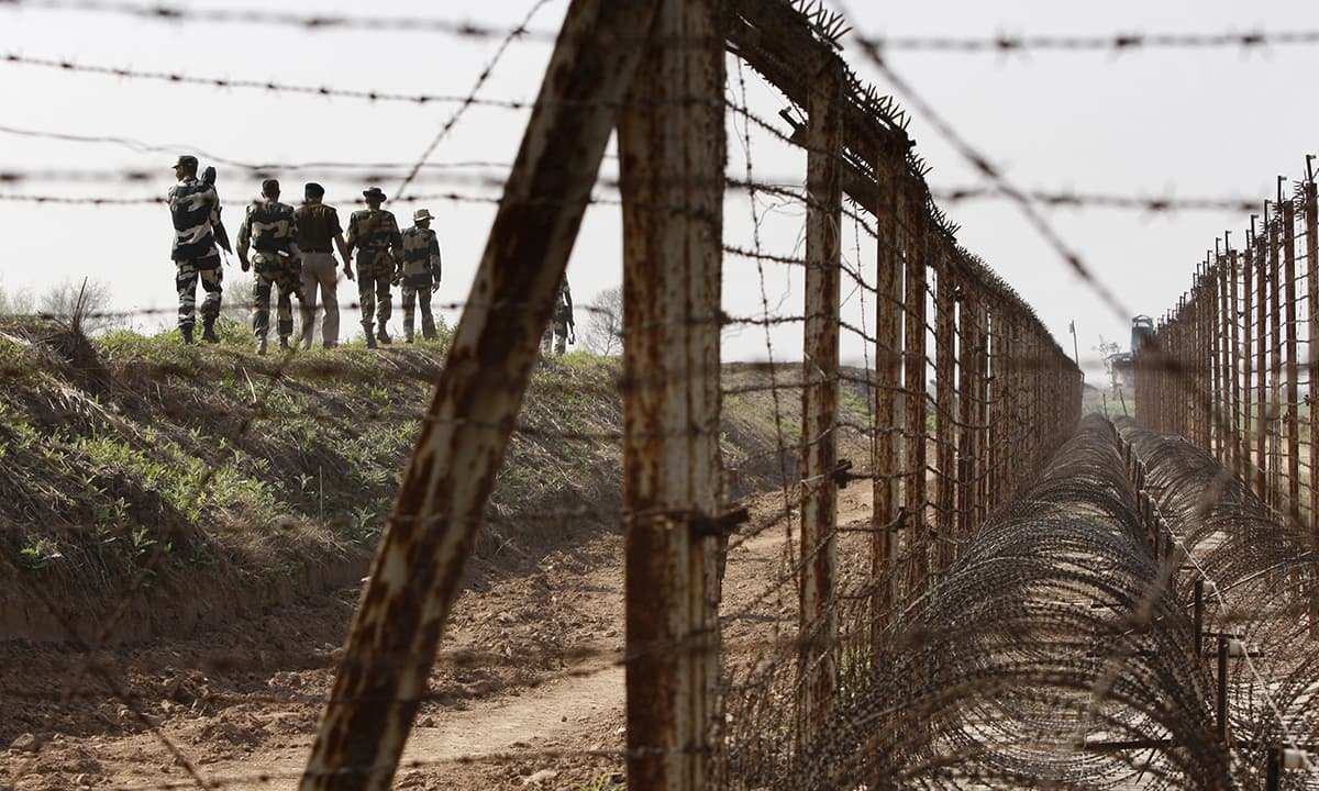 Indian soldiers patrol the India-Pakistan border in March 2016 | AP