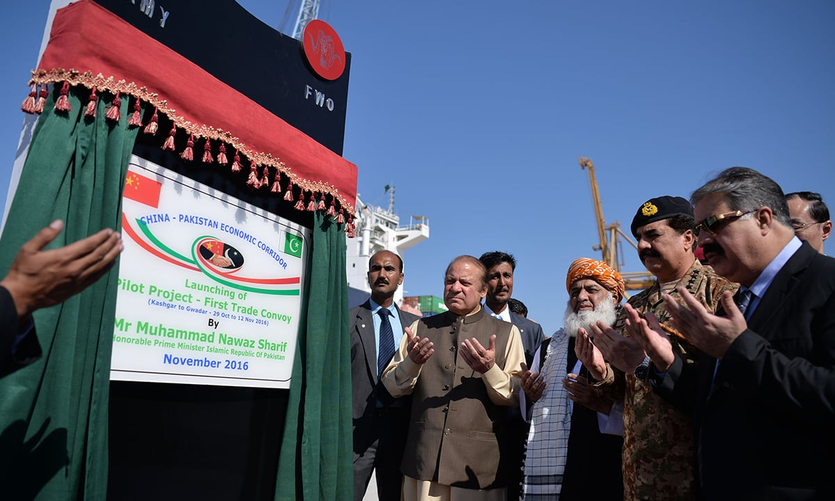 Prime Minister Nawaz Sharif offers prayers at the opening ceremony of a pilot trade project at Gwadar port | AFP