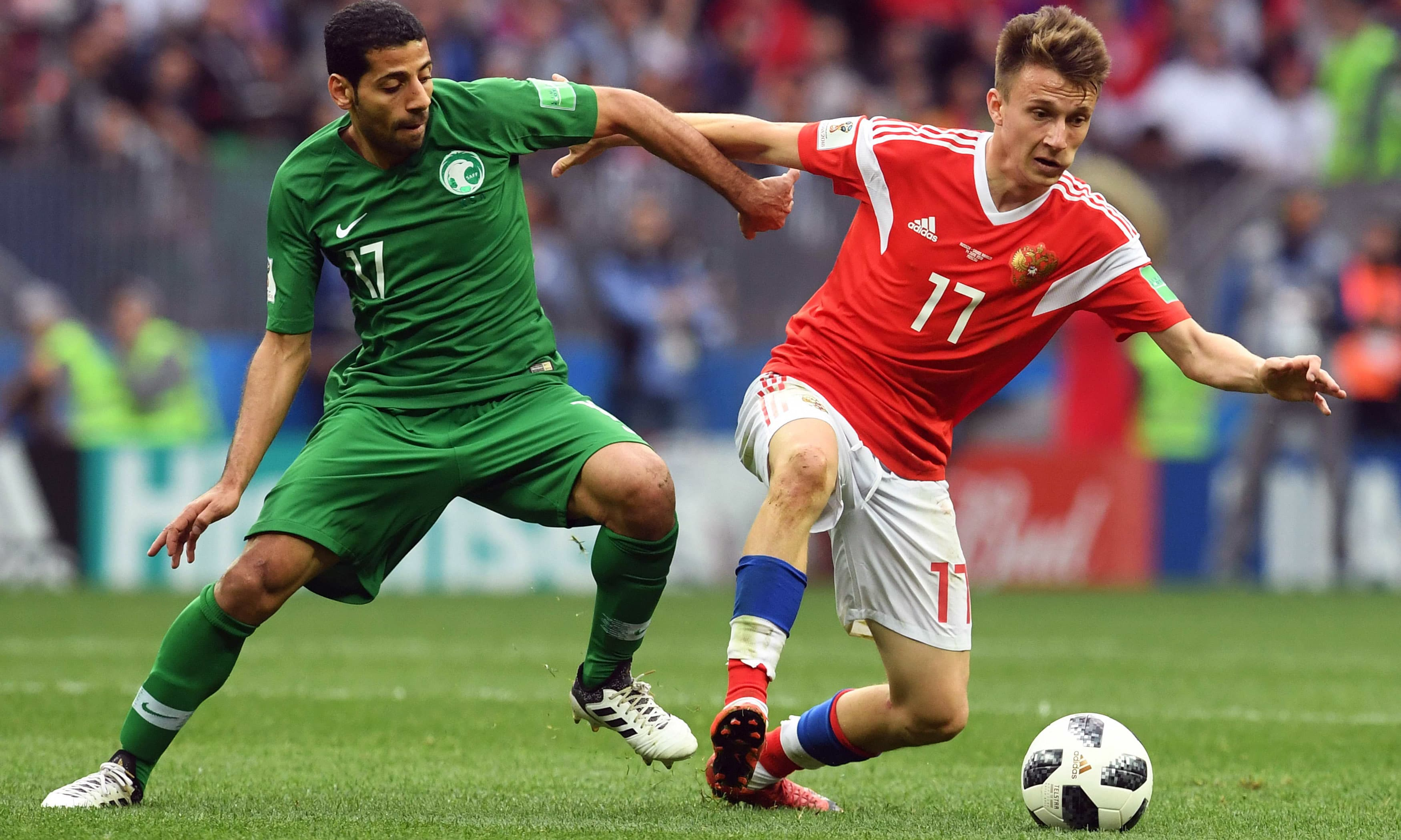 Taisir Al-Jassim vies with Russia's midfielder Aleksandr Golovin. —AFP