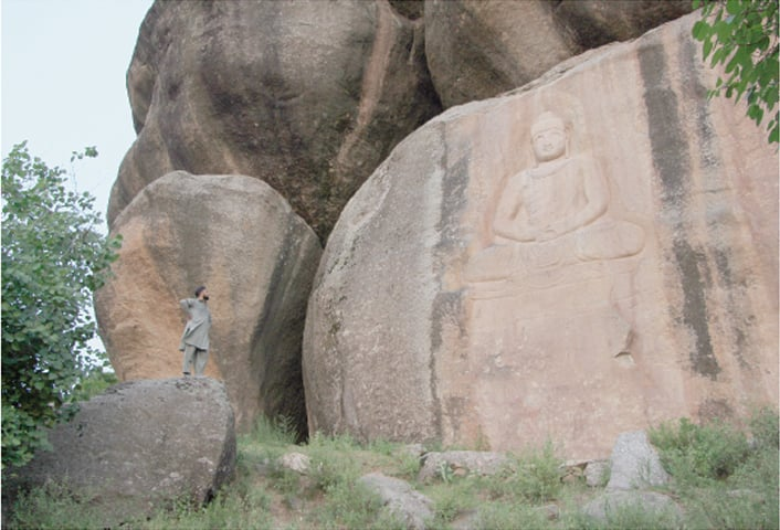 A magnificent Buddha keeps watch over the lower reaches of Swat