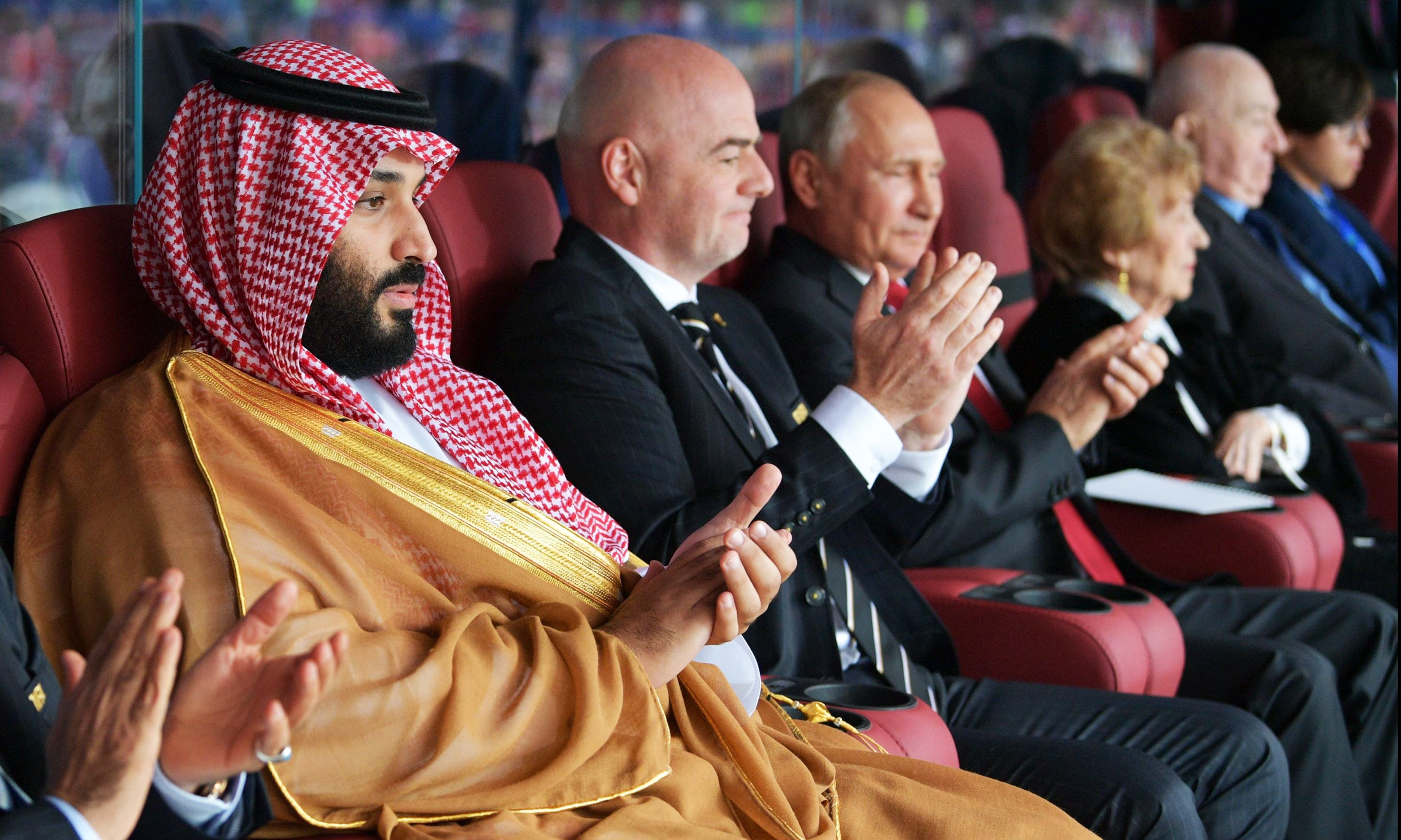 Saudi Crown Prince Mohammed bin Salman, FIFA president Gianni Infantino and Russian President Vladimir Putin watch the ceremony. — AFP