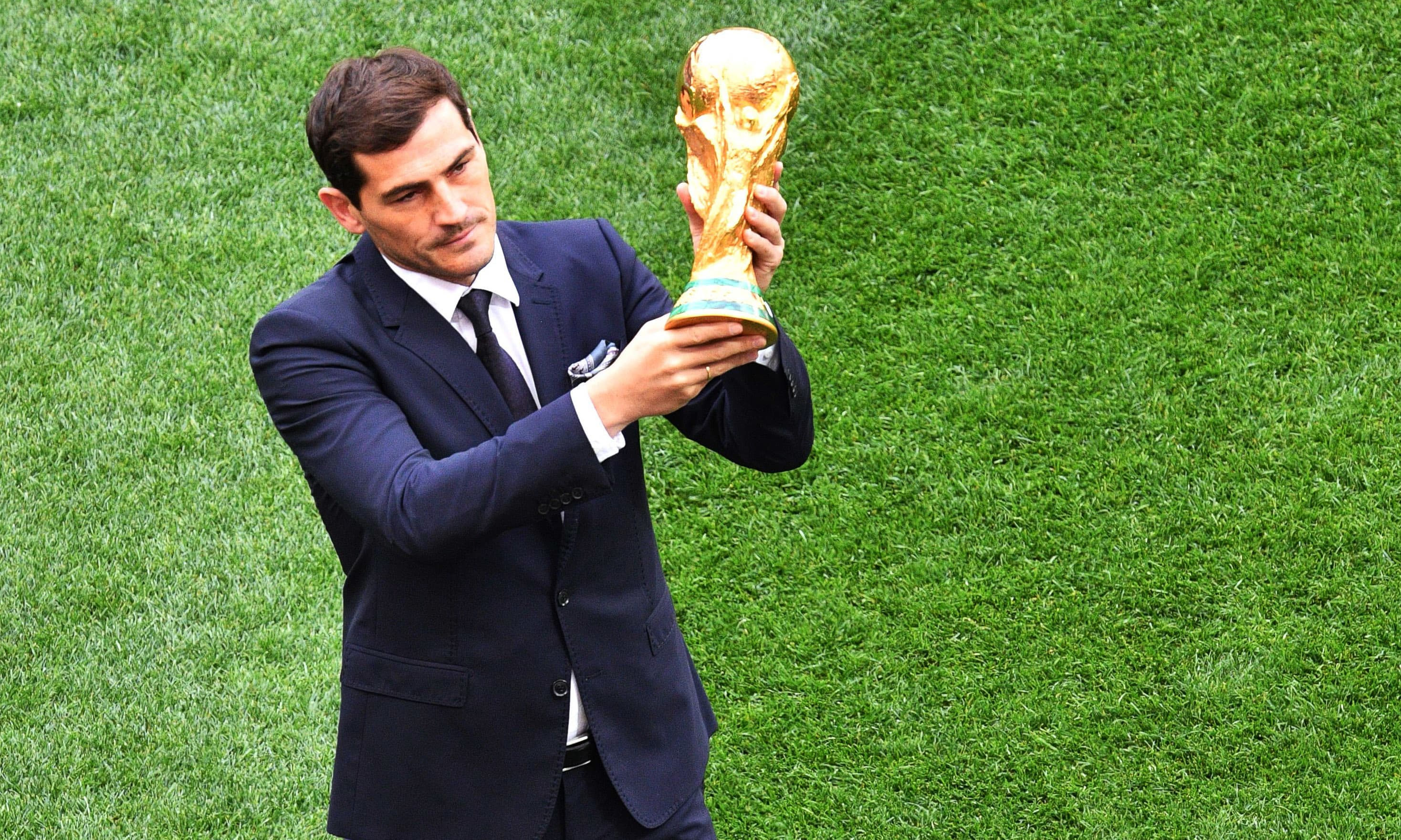 Spanish goalkeeper Iker Casillas holds the World Cup trophy during the Opening Ceremony before the Russia 2018 World Cup Group A football match between Russia and Saudi Arabia at the Luzhniki Stadium in Moscow on June 14, 2018. — AFP