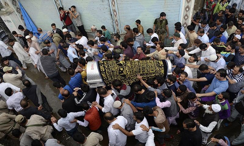 Kashmiri Muslims carry the coffin of slain editor-in-chief of the Srinagar-based newspaper *Rising Kashmir* Shujaat Bukhari during a funeral procession at Kreeri, some 40km north of Srinagar on Friday. — AFP