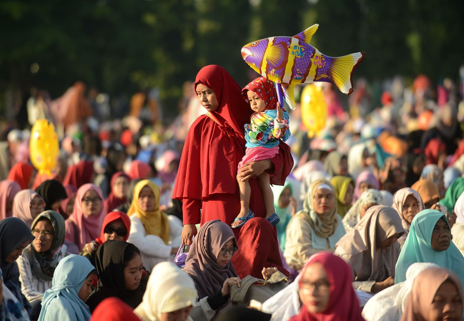 Indonesia Muslim people take part in a special morning prayer celebrating Eid festival at Bali's Bajra Sandhi monument and park in Denpasar. — AFP