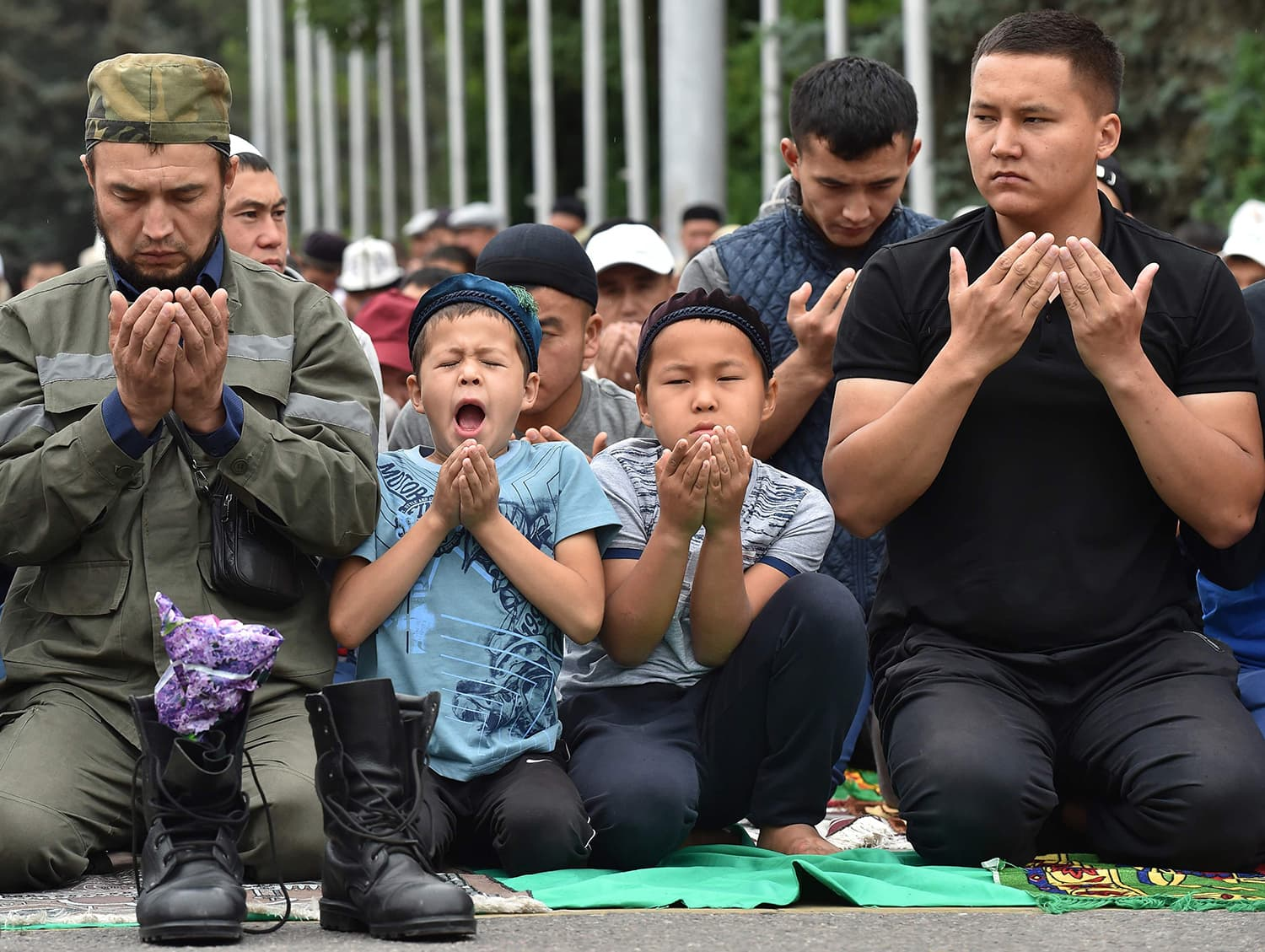 Kyrgyz Muslims pray in the central of Bishkek during celebrations of Eidul Fitr. — AFP