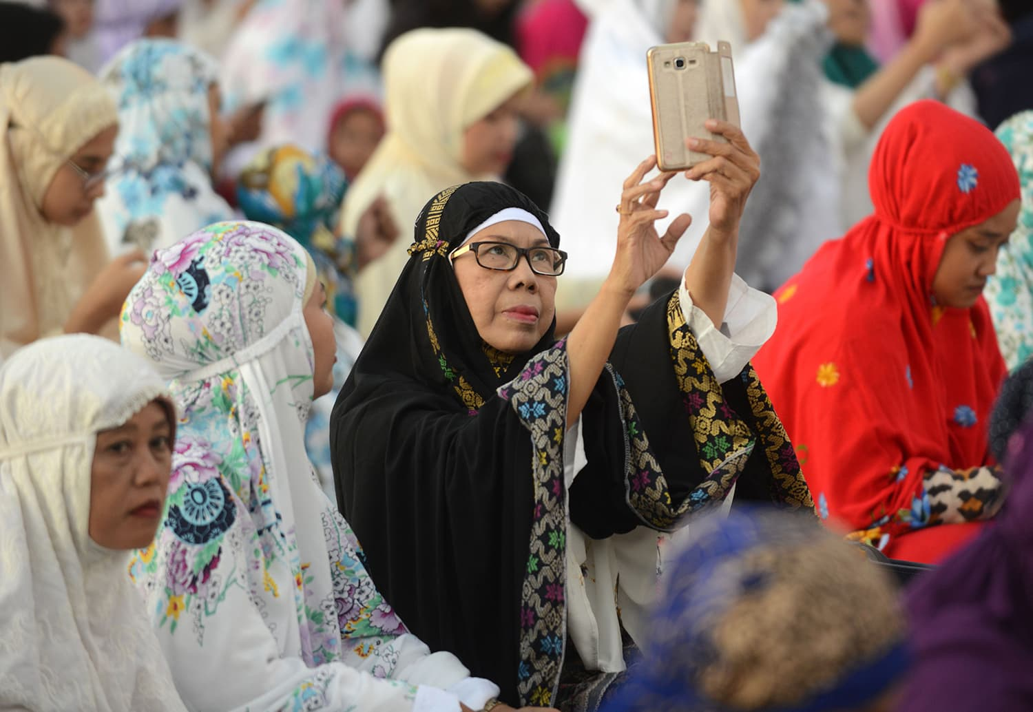 Indonesian Muslim women take part in a special morning prayer celebrating Eidul Fitr festival at Bali's Bajra Sandhi monument and park in Denpasar. — AFP