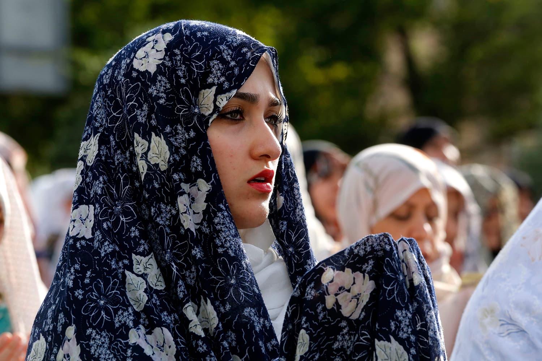 A Iranian Muslim woman performs Eidul Fitr prayers in western Tehran. — AFP