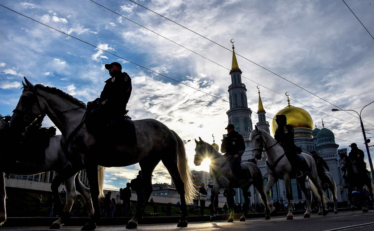 Russian mounted police patrol near the central Mosque in Moscow during the celebrations of Eidul Fitr. — AFP