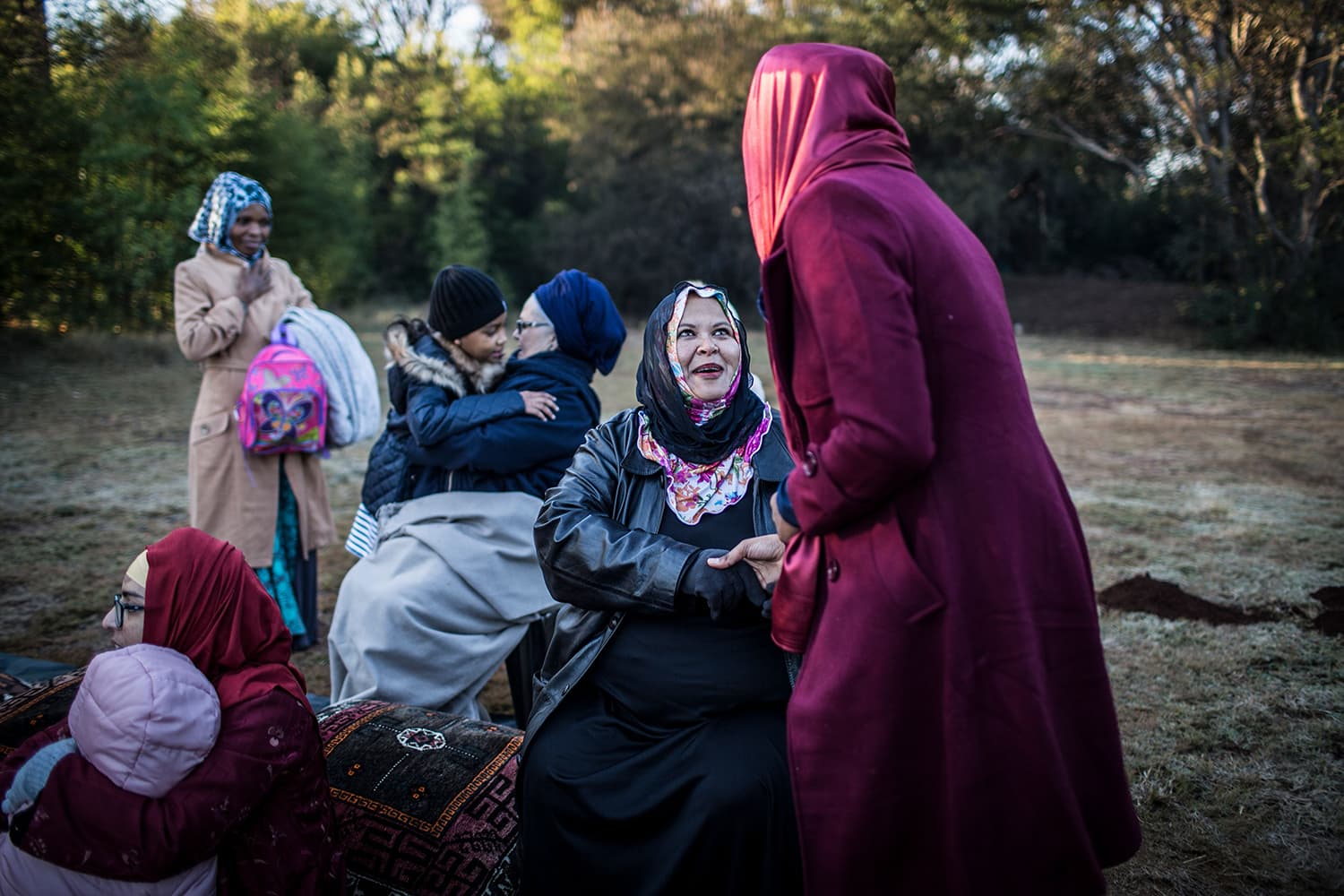 Women greet each other at the Rasooli Masjid in Pretoria, South Africa on the occasion of Eidul Fitr. — AFP