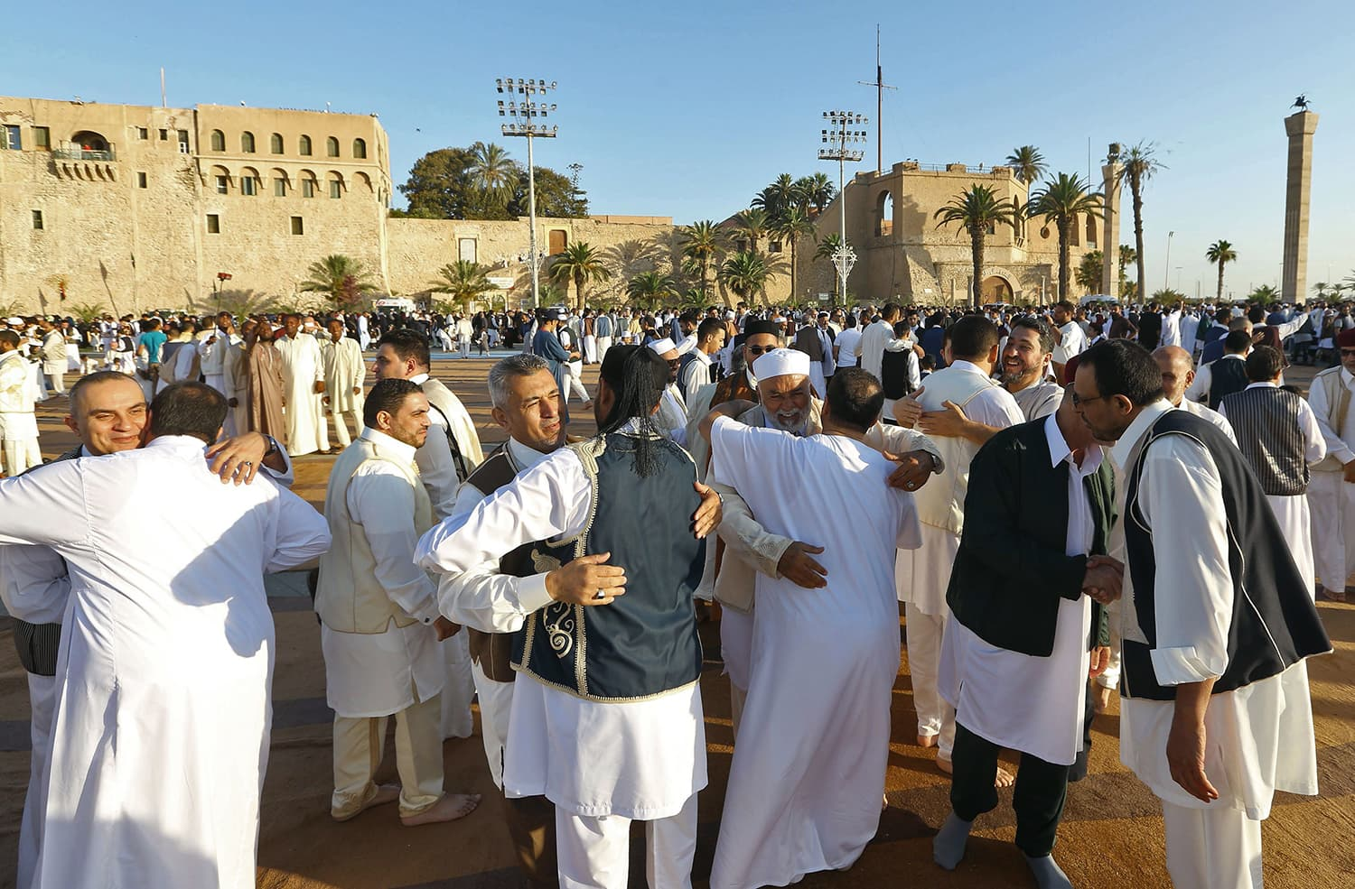 Libyan Muslim worshipers gather to perform Eidul Fitr prayers at the Martyrs' Square in the capital Tripoli. — AFP