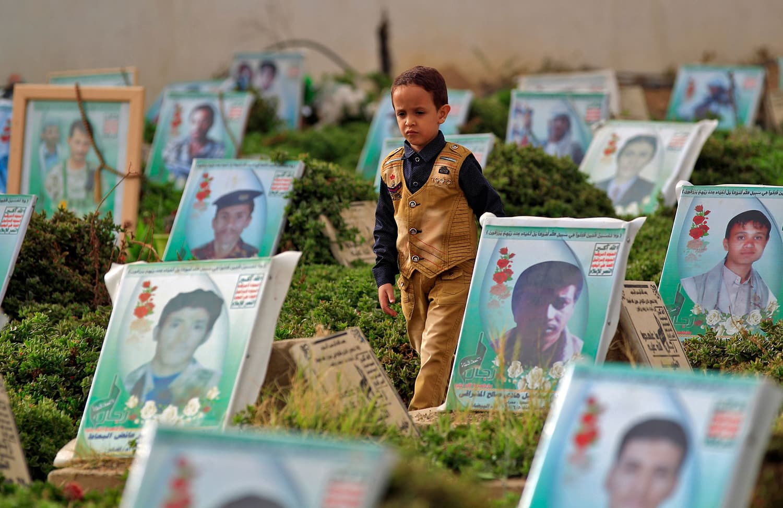 A Yemeni boy walks in a cemetery in the capital Sana'a after the Eidul Fitr prayers. — AFP