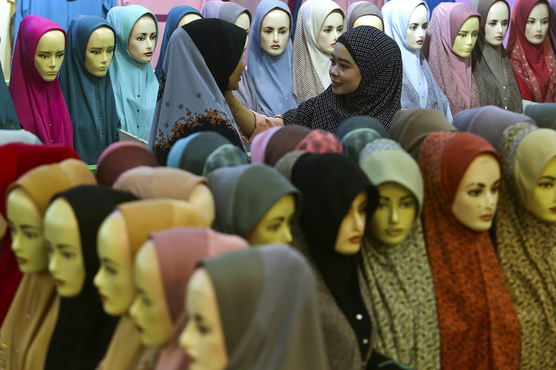 In this file photo Muslim women shop for headscarves at a Ramazan bazaar in Kuala Lumpur, Malaysia. — AP