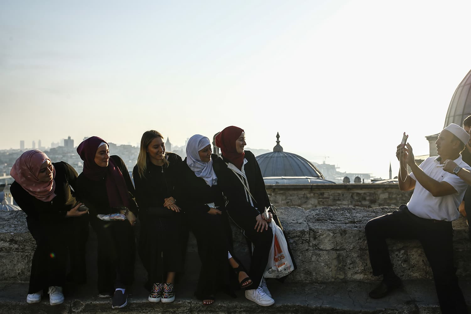 Backdropped by Istanbul's skyline, people enjoy the first day of Eidul Fitr. — AP