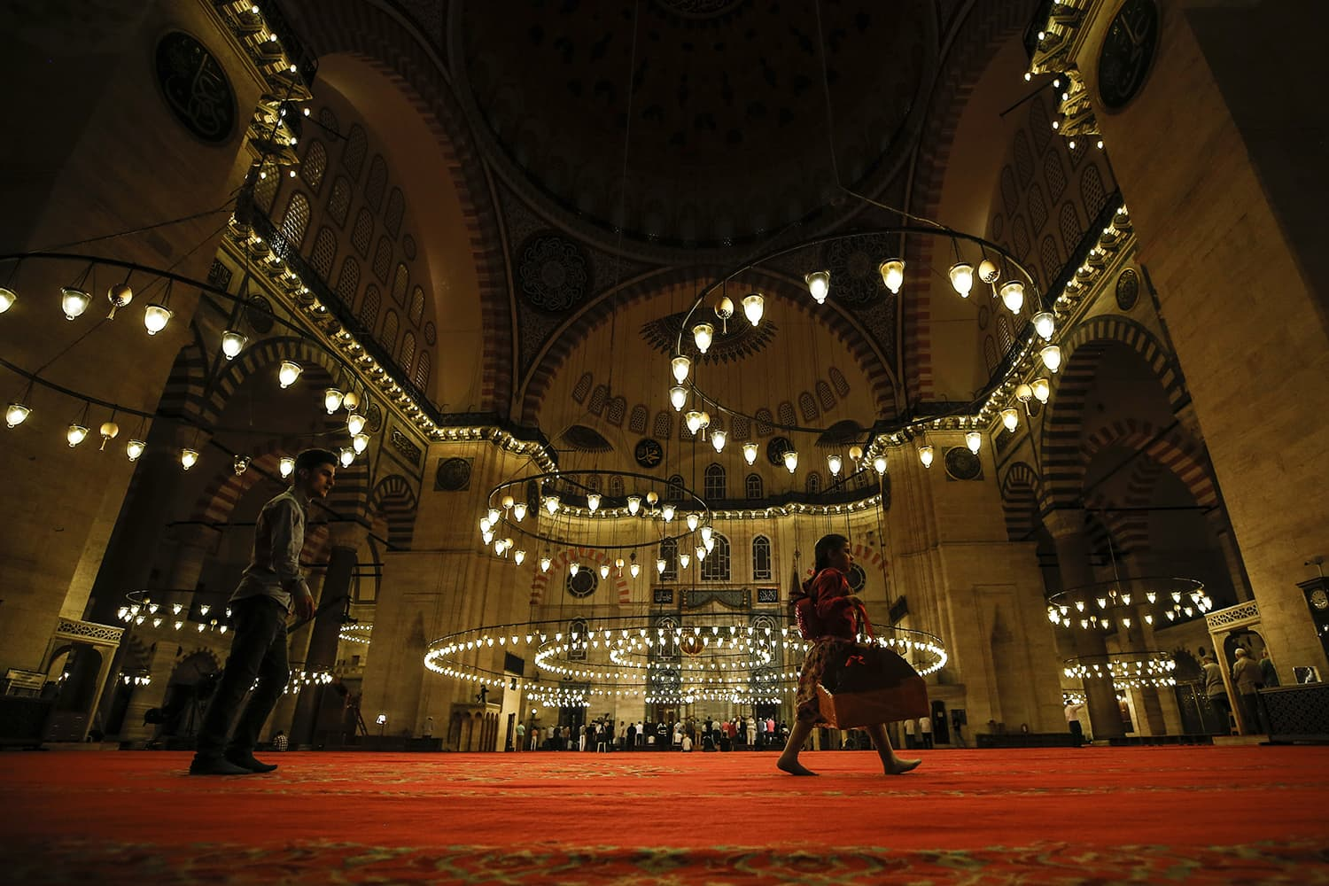Turkey's Muslims arrive to offer prayers on the first day of Eidul Fitr at the the Suleymaniye Mosque in Istanbul. — AP