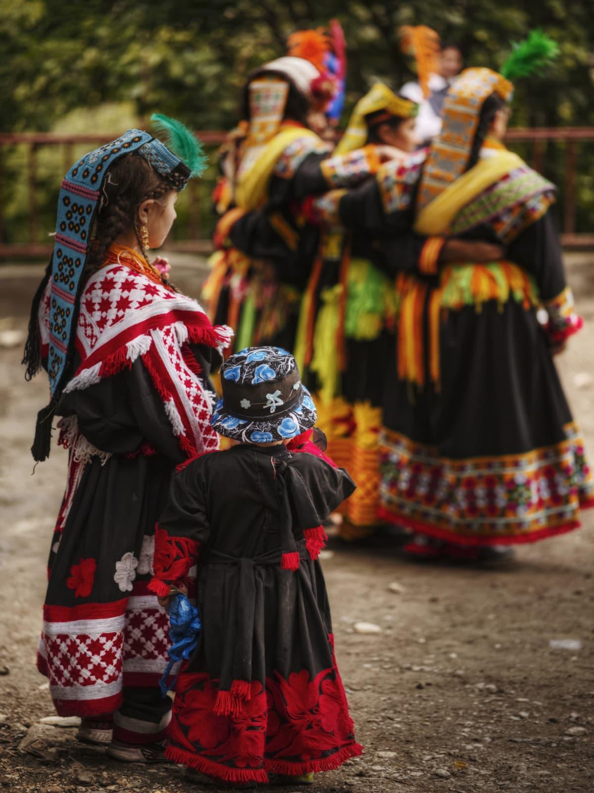 Children observe their elders perform a ritual dance