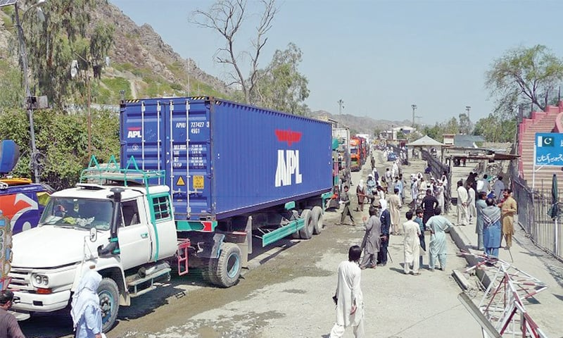 Container trucks loaded with Afghan goods entering Pakistan via Torkam border. — Dawn