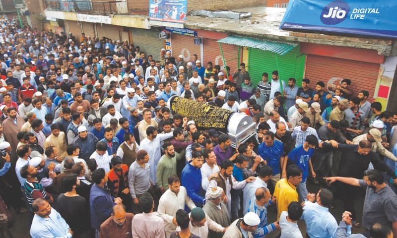 Srinagar: People carry the body of Syed Shujaat Bukhari, the editor-in-chief of Rising Kashmir, during his funeral in Kreeri, north of Srinagar,  on Friday.—Reuters