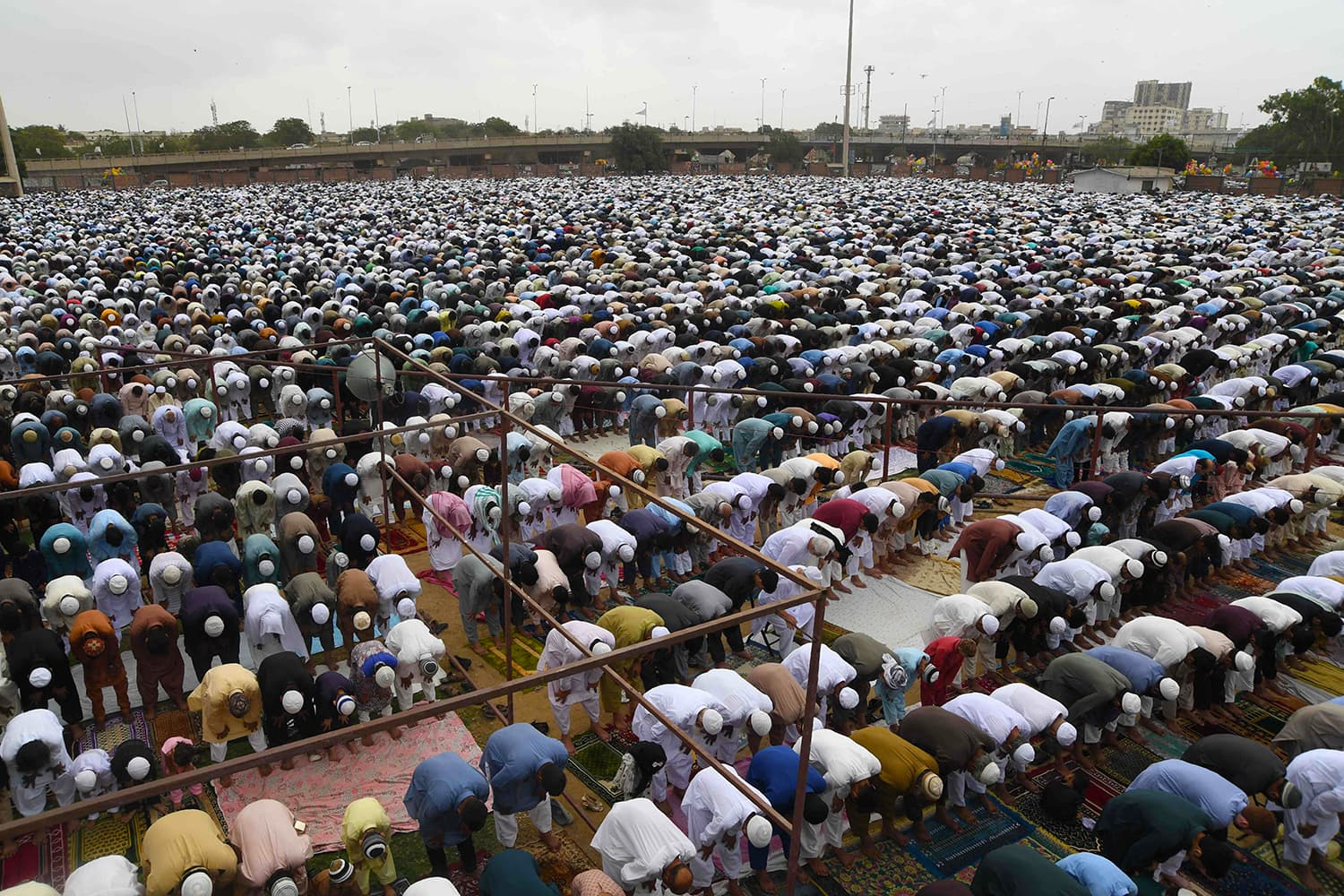 Muslims offer Eidul Fitr prayers at an Eidgah ground in Karachi. — AFP