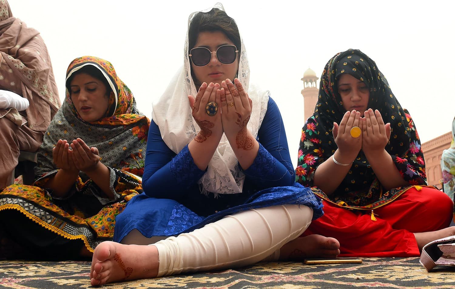 Women pray to mark Eidul Fitr at the Badshahi Mosque in Lahore. — AFP