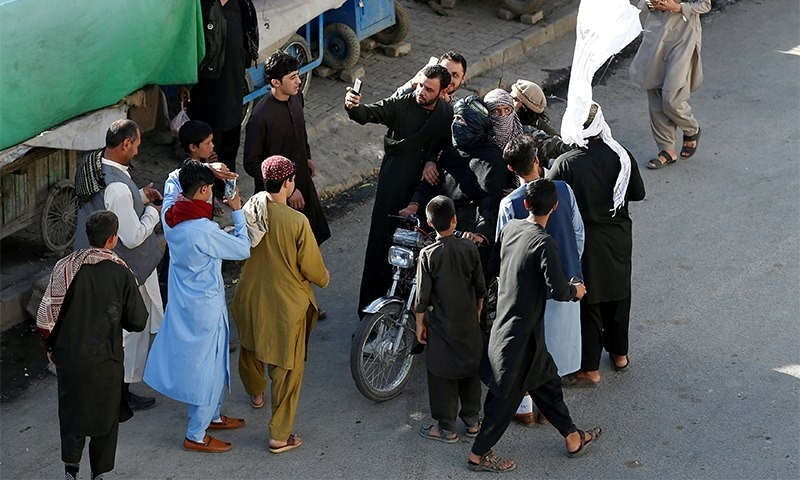 People take selfies with Taliban in Kabul on Eid. ─ Reuters