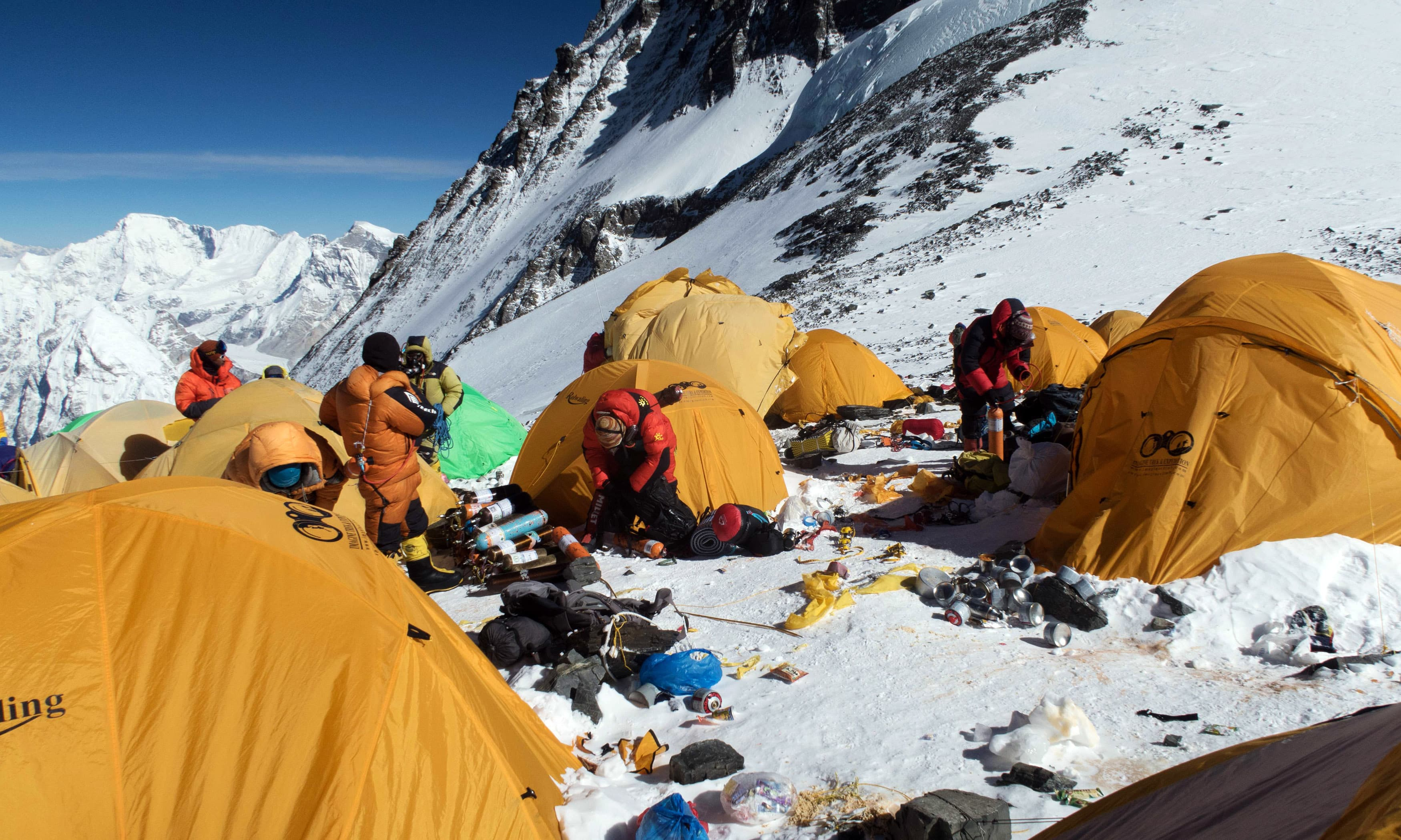 Melting glaciers caused by global warming are exposing trash that has accumulated on the mountain for decades. —AFP