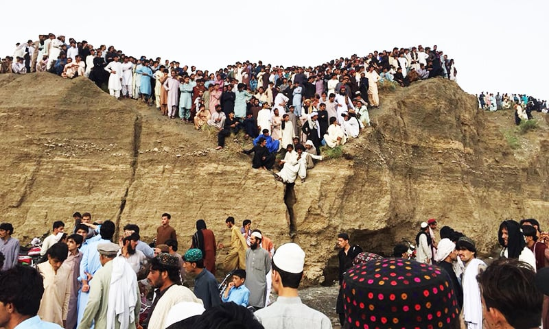 People gather at the site of land sliding incident in Zhob.— Hafeezullah Sherani