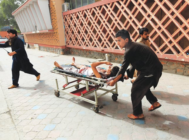 AN injured man is being taken to a hospital after a bomb blast in Jalalabad city of Afghanistan on Sunday.—Reuters