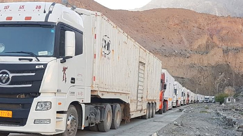 A LONG queue of container trucks stalled at Sost behind the site of the sit-in blocking the Karakoram Highway.—Photo by writer