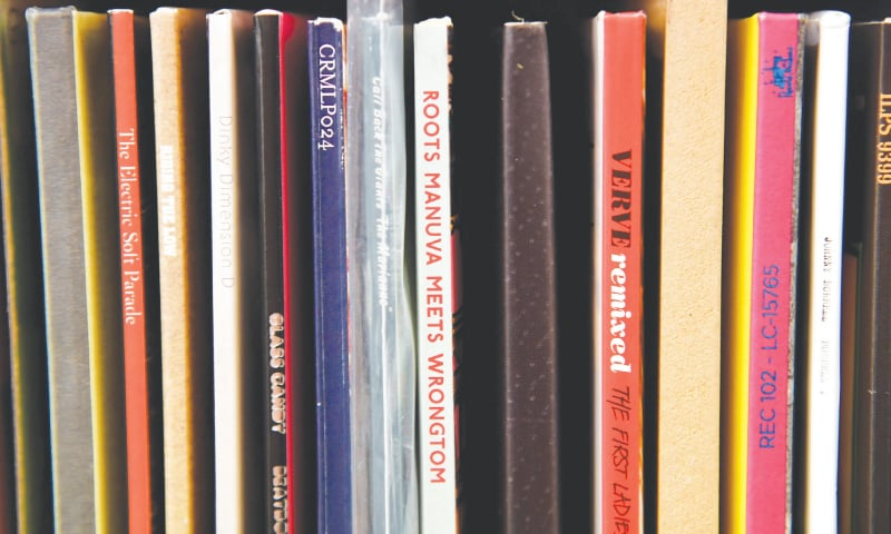 VINYL LP album record sleeve spines are seen archived at the British Library's musical collection in London.—Reuters