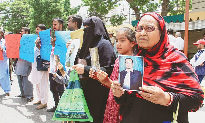 KARACHI: Relatives of missing persons hold a protest outside the Supreme Court registry on Sunday.—PPI