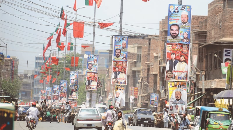 FLAGS and posters of different political parties, including the Awami National Party, Pakistan Tehreek-i-Insaf, Muttahida Majlis-i-Amal, on display around Circular Road as parties start preparing for the 2018 polls. —Shahbaz Butt/White Star