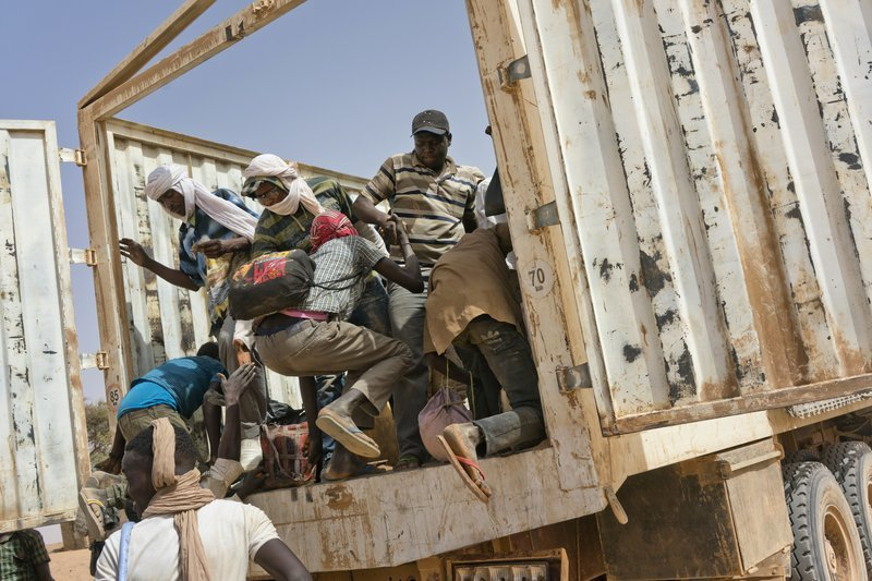 Migrants climb into a truck to head north into Algeria at the Assamaka border post in northern Niger on June 3. ─ AP