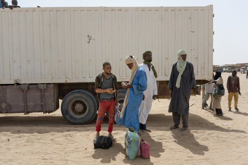 Migrants pay to head north into Algeria at the Assamaka border post in northern Niger on June 3. ─ AP